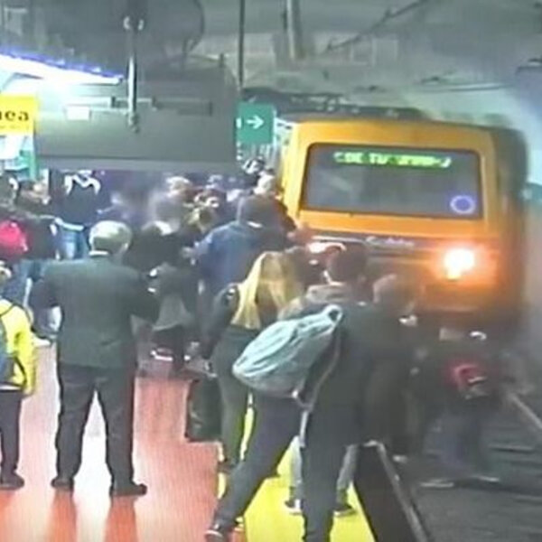 What's Viral - Commuters stop oncoming train to rescue woman who fell on tracks