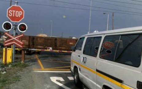 What is being done regarding level crossings in Cape Town?